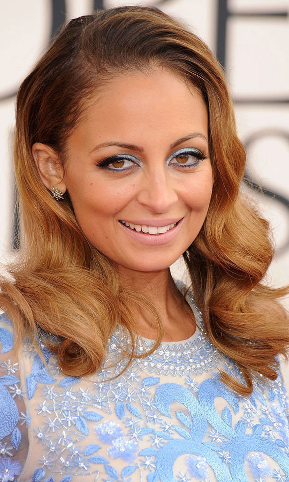 Fashion darling Nicole Richie added a pop of icy blue eye shadow to match her dress, and, of course, some on-trend, old-school hair waves.