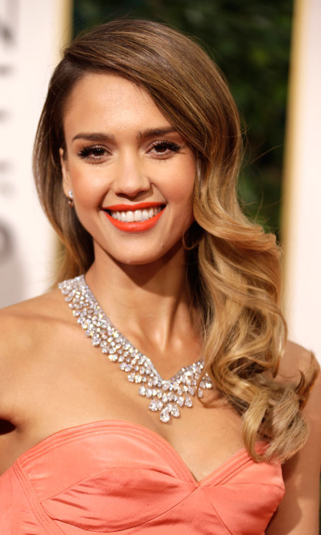 A vibrant shade of coral lipstick showcased Jessica Alba's beautiful skin tone. Her ombre-dyed hair — a ubiquitous trend last season — was worn in romantic waves.