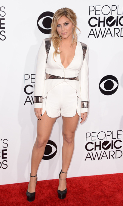 'Sharknado' actress Cassie Scerbo in a white blazer and matching white shorts with silver detailing. Photo: © Getty Images