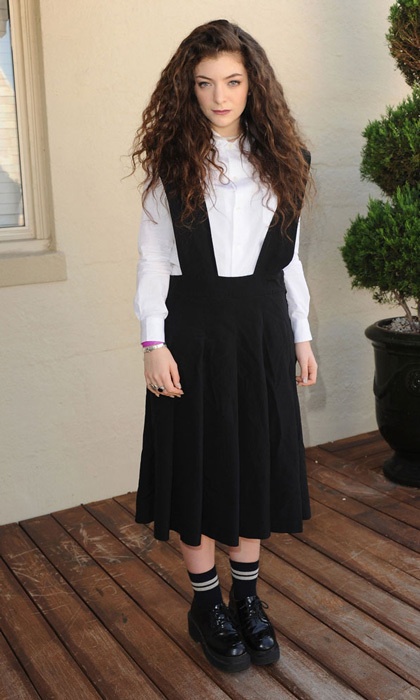 "Simple black and white is Lorde's go-to look, but when it comes to accessorizing, the New Zealand-born singer admits, ""I have a really weird shoe game. I like chunky oxfords (here promoting her debut album in New York) or platform sneakers."""
