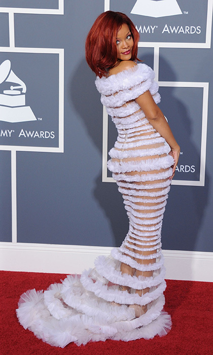 "It's hard to forget Rihanna's racy look at the 2011 Grammy Awards. The singer left little to the imagination in this over-the-top Jean Paul Gaultier frock, which alternated between sheer and white-tulle paneling from top-to-bottom. The ""We Found Love"" songstress's beauty look kept the drama at play with bold red hair and matching lips."