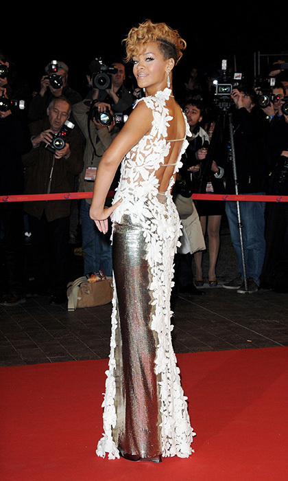 The Barbados native showed a softer side at the 2010 NRJ Music Awards, looking demure in a white floral-embroidered piece by Jean Paul Gaultier. The couture gown, which split to the thigh revealing a silver metallic skirt, included a high neck and open back. Rihanna's tousled mohawk prevented her unusually dainty dress from looking too prim.