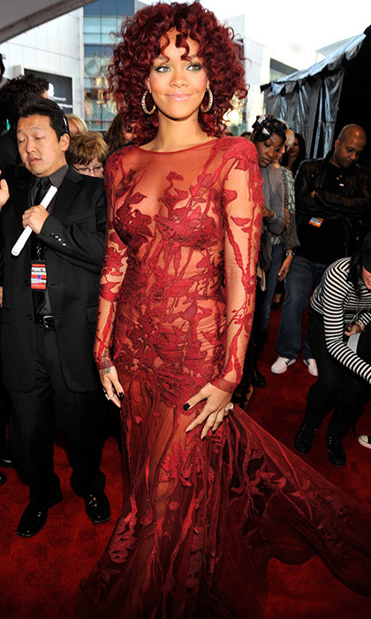 Heads turned when Rihanna hit the American Music Awards red carpet in this jaw-dropping Ellie Saab Couture gown in 2010. The floor-length berry-hued ensemble with long sleeves was embellished with delicate floral patterns and a mesh underlay.