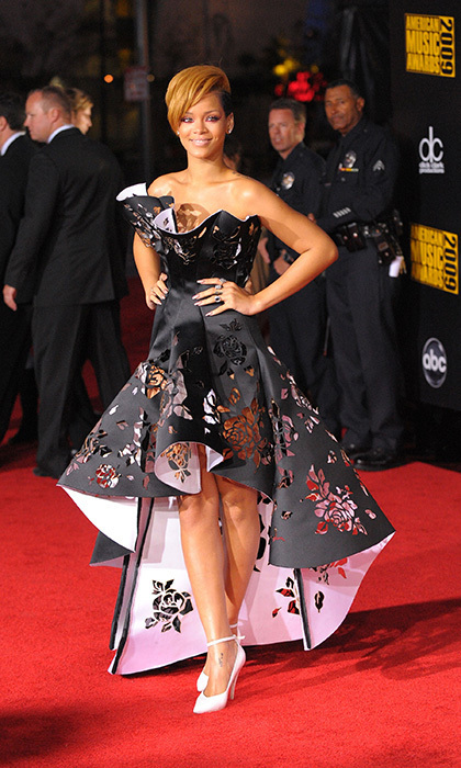 "Rihanna was mesmerizing in this two-toned, black-and-white Marchesa dress at the American Music Awards in 2009. The structured gown with rise-and-fall hemline and rose cutouts made a bold statement on the red carpet before the entertainer took to the stage to perform her hit, ""Hard."""