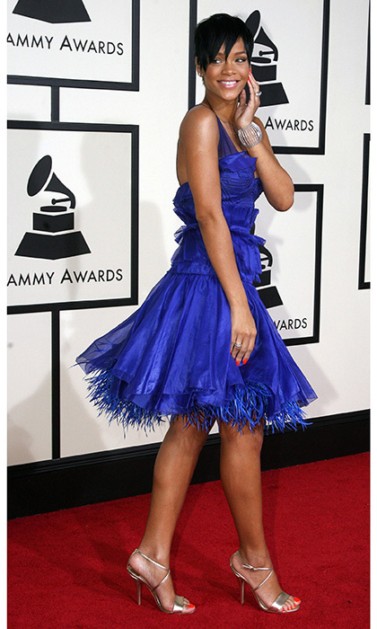 Rihanna went fun and fresh for the 2008 Grammy Awards in this cobalt, knee-length Zac Posen frock. The flirty ensemble adorned in frills included a full, feathery hemline and was accompanied by Jimmy Choo shoes and Chopard accessories.