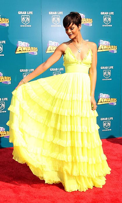 Like a ray of sunshine, Rihanna beamed on the BET Awards red carpet in 2008. The striking beauty donned a neon-yellow Giambatista Valli ruffled maxi, pairing the eye-catching ensemble with a silver pendant, smokey eyes and sultry plum lips.