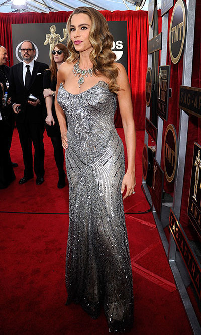 Back to va-va-voom, Sofia chose Donna Karan Atelier at the 2014 SAG Awards, bringing her hourglass figure back out of hiding and pairing the silver, heavily beaded gown with glamorous side-parted waves.
