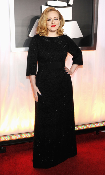 "Rolling in a deep black shift by Giorgio Armani, Adele looked elegant on the red carpet, having recently landed her first 'Vogue' cover. The chanteuse sang a powerful rendition of ""Rolling in the Deep"" and took home a staggering six awards!"