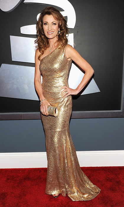 One of Hollywood's notoriously slow-to-age beauties, Jane Seymour matched her golden curls with a gold, one-shoulder dazzler by David Meister.