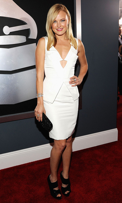 Swedish-Canadian actress Malin Akerman, who is part of a jazz band called Malin and the Mystic Cats, hit the red carpet in a stark-white, geometric mini dress with an understated triangular cutout below the neckline.