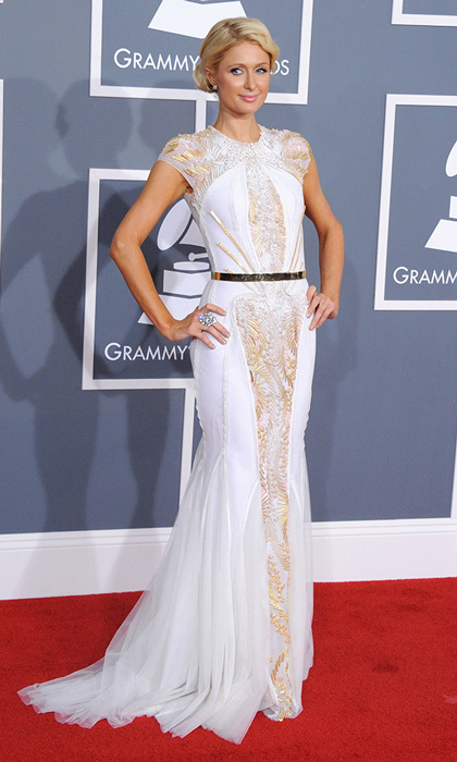 Paris Hilton looked uncharacteristically elegant at the 2012 Grammys with light makeup, a messy updo and a ladylike, white-and-gold Basil Soda gown with a slim metal belt.