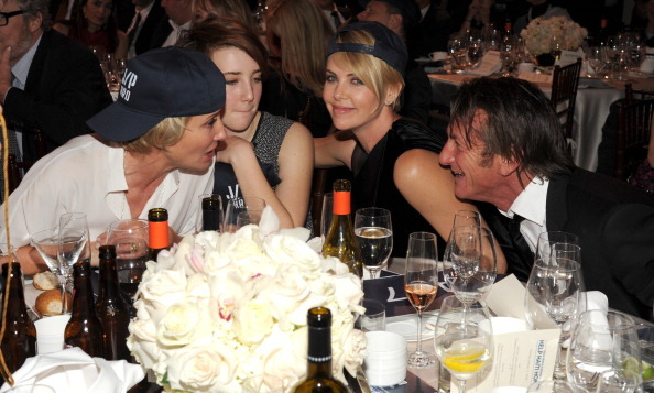 The couple were joined at their table by Emma Thompson and Gaia Wise. (Photo: Getty)