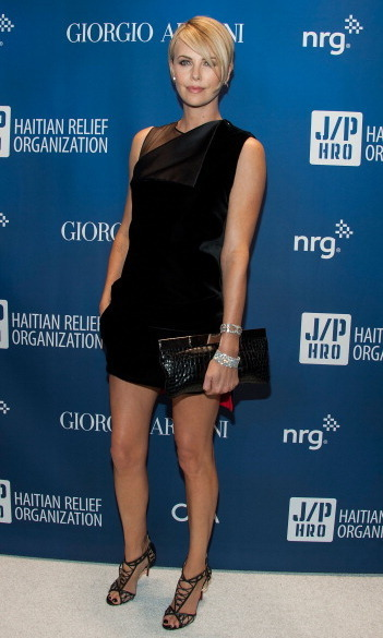 Charlize looked dazzling as ever in a Givenchy black mini-dress and Christian Louboutin heels.  (Photo: Getty)