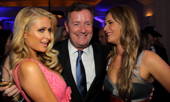 Besides chatting with Charlize and Sean, Piers Morgan rubbed elbows with the Paris Hilton -- and of course, his wife Celia Walden. (Photo: Getty)