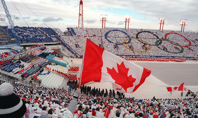 Fans cheered and waved flags as the Canadian delegation (lower right) paraded during the opening ceremony of the 15th Winter Olympic Games in Calgary, 1988.
