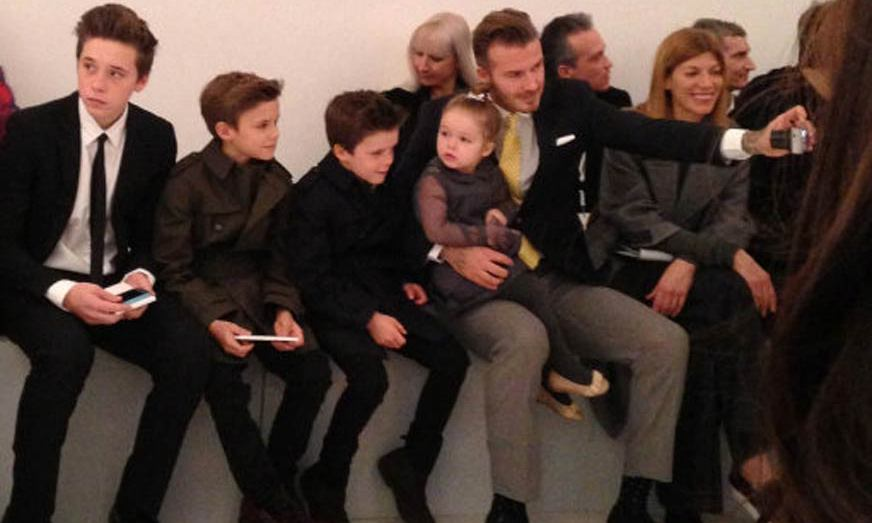 David takes a selfie with his four children while waiting for Victoria's fashion show to start. Photo: © PA