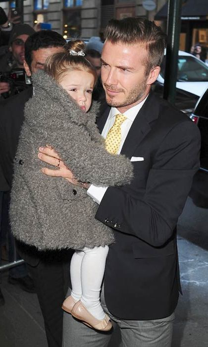David carries Harper to lunch after the fashion show. Photo: © Getty Images