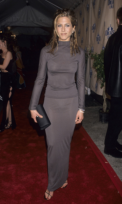 The actress flaunted her incredible figure in a covered, yet curve-hugging, grey dress in 1998. Photo: © Getty Images