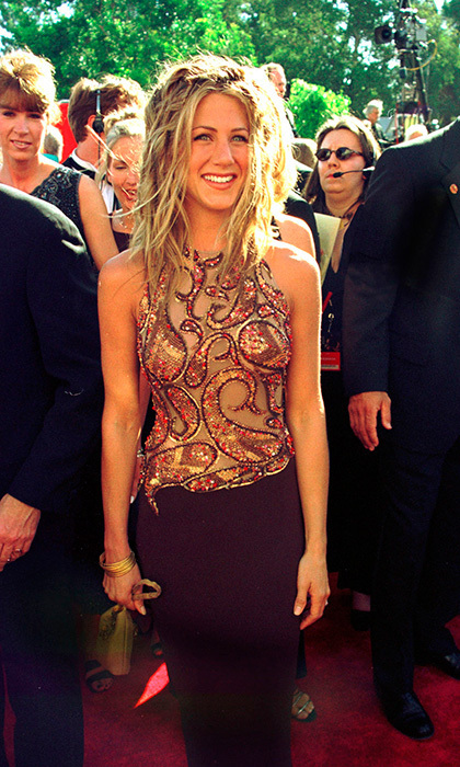 For the 1999 Emmy Awards, Jen showed off her glowing tan in a sequined halter top. Photo: © Getty Images