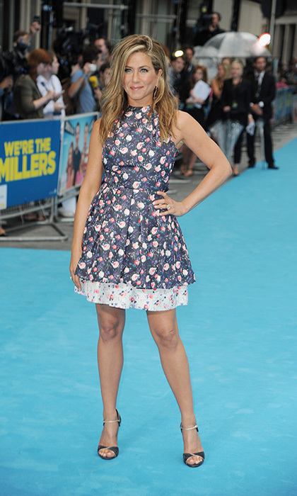 Jennifer surprised everyone at the London premiere of 'We're the Millers' wearing a ruffly, floral Dior dress and her hair worn tousled in a deep side part.