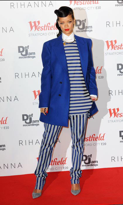 We're getting a serious 1980s vibe from this unusual, navy-striped ensemble, which Rihanna sported for the lighting of the Westfield Stratford Christmas lights in 2012. She paired the look with an oversized Raf Simons blue jacket.