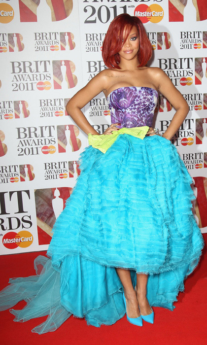 Rihanna stood out from the red carpet crowd in a multi-coloured, Christian Dior dress with a high-low skirt at the 2011 Brit awards.