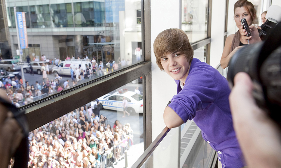 By September of 2009, Justin Bieber was already a megastar. A crowd of fans awaited him during his visit to the Nintendo World in New York City. Photo: © Getty
