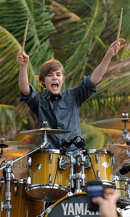 In Feb. 2010, the multi-talented pop sensation tried his hand at drumming while performing on CBS News 'The Early Show' in South Beach. Photo: © Getty