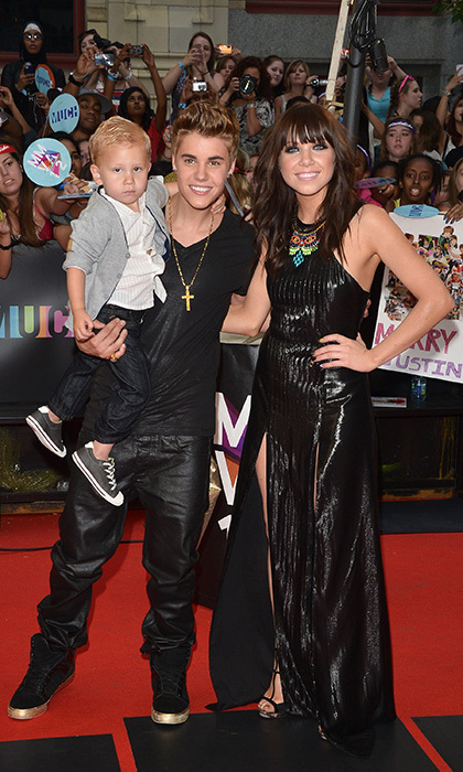 "For the 2012 MuchMusic Video Awards, Justin Bieber brought his adorable little brother Jaxon. Justin, who is a big fan of Carly Rae Jepsen's hit single ""Call Me Maybe,"" also walked the red carpet with the Canadian songstress. Photo: © Getty"