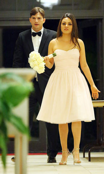 The pair attended Ashton's brother Michael Kunis' wedding to Alexandra Blacker in St. Petersburg last December. Their dapper appearance – Mila in a romantic pale pink dress and Ashton donning a smart tux – prompted speculation as to whether they would be next to walk down the aisle. Photo: © Splash