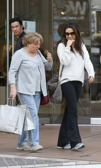 Mila Kunis was seen doing some shopping with her mom, Elvira Kunis, at Nordstrom's in West Hollywood this week. The actress was dressed casually in a white sweater and black spandex pants, but she did add one glamorous accessory – an impressive diamond ring. Photo: © Splash