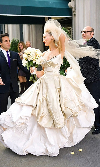 The dramatic scene of Mr. Big leaving Carrie at the altar in the 'Sex and the City' movie required an equally dramatic Vivenne Westwood wedding gown. The actress added a blue feather fascinator in her hair for extra pizzazz.