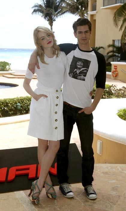 Kicking off the press tour, costars (and real-life couple) Emma Stone and Andrew Garfield cozied up in Cancun for a very stylish yet laid-back look. Emma wore a white Dolce & Gabbana ensemble, which featured a beaded collar and gold buttons on the skirt, and contrasted her relaxed, beachy hair with a pair of fierce Brian Atwood sandals and a bright red lip. Andrew, meanwhile, paid homage to Canada by sporting a Michael J. Fox T-shirt!