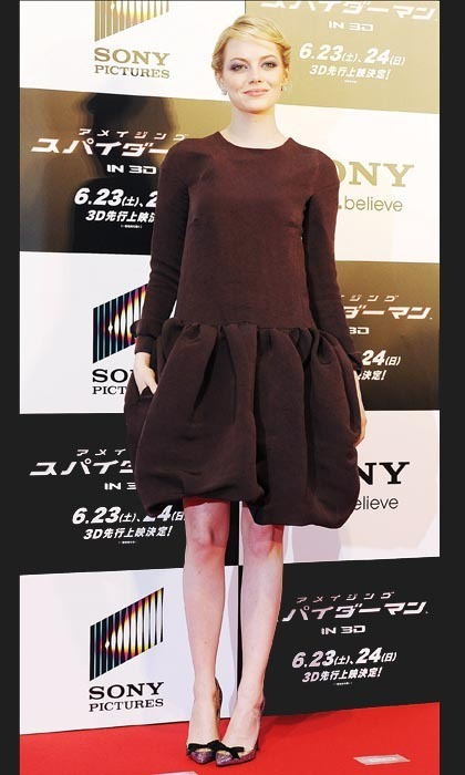 Emma was the picture of elegance in a frothy, chocolate-brown Rochas dress with a voluptuous bubble skirt at another Tokyo event. The ladylike look came to fruition with a pair of 'Love Me' metallic Christian Louboutin pumps adorned with black bows.
