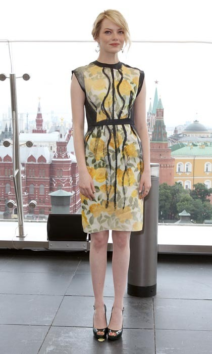 Emma dazzled in a yellow, hand-painted Lanvin dress and dangling Nikki Baker earrings at another stop in Moscow. Of course, the petite star heightened the look – and herself! – in a pair of patent-leather peep-toe pumps by mainstay Brian Atwood.