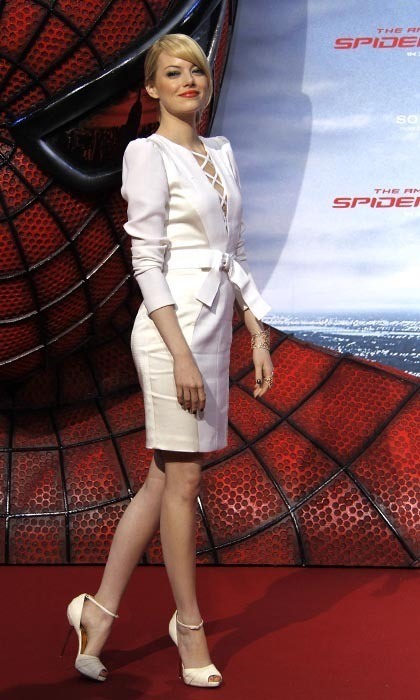 In another spiderweb-inspired look – but with a much airier feel – Emma slipped into an all-white Andrew Gn outfit that featured a criss-cross pattern on the front and a satin bow belt.
