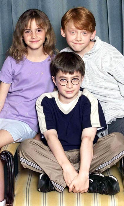 Fresh-faced Emma posed with her 'Harry Potter' costars, Daniel Radcliffe and Rupert Grint, shortly after being selected to star in the series in 2000. (Photo by Dave Hogan/Getty Images)