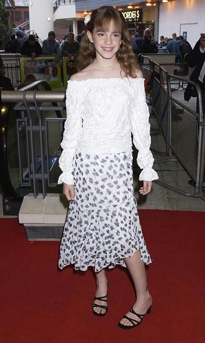 Wearing a peasant top, a long skirt and a flower in her hair, Emma was cute as a button at a movie premiere in 2002. (Photo by Dave Benett/Getty Images)