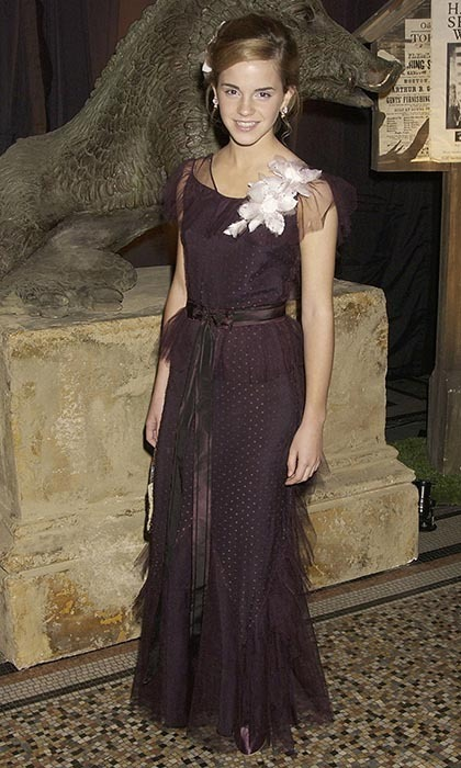 For a 2004 'Harry Potter And The Prisoner Of Azkaban' party in London, the young starlet turned up the glam factor in a deep-plum gown with a delicate pink floral appliqué on one shoulder.