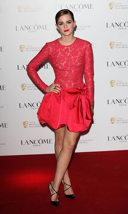 For her second Orange British Academy Film Awards party in 2012, Emma wore a cherry-red Valentino number, paired with Christian Louboutin shoes and red lipstick from her own collection for Lancôme called Rouge in Love.(Photo by Tim Whitby/Getty Images)