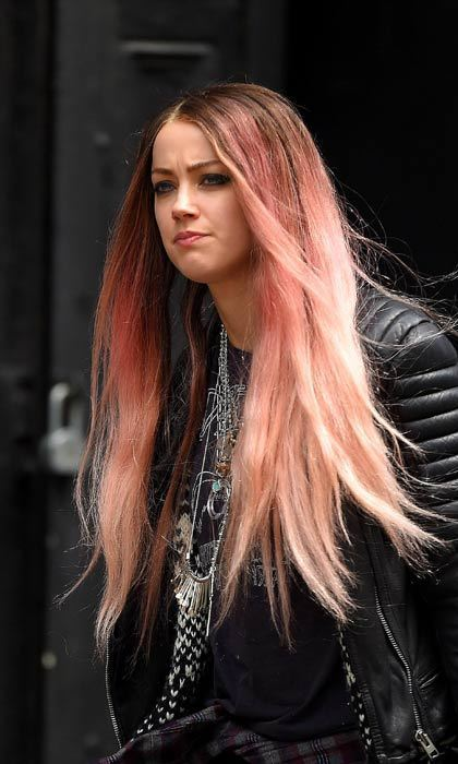 Amber Heard stepped out in an ombre pink wig while filming her new film.  Photo: © Getty Images