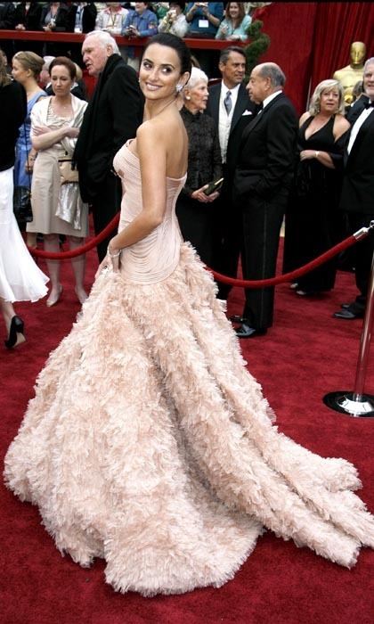 Arguably one of Penelope's most iconic looks (and one of the best dresses to ever grace the Oscars red carpet!), the star turned heads in a glamorous, dusty rose Versace confection, which featured a feather-detailed skirt. (Photo by Steve Granitz/WireImage)