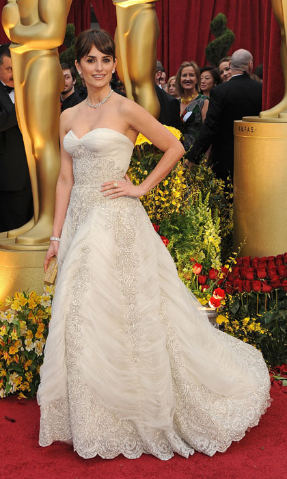 The mother of two took home the Oscar for her role in 'Vicky, Cristina, Barcelona' in 2009 while sporting a Pierre Balmain vintage strapless gown. A delicate string of Chopard diamonds and a romantic updo completed the dreamy look.  (Photo by ROBYN BECK/AFP/Getty Images)