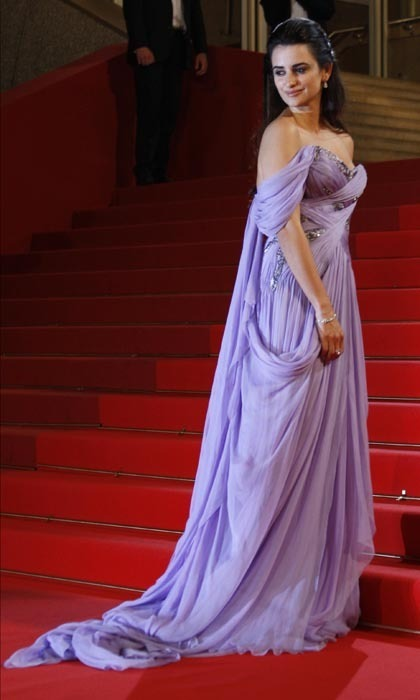 Penelope shone at the Cannes Film Festival in 2009 in a draped lilac gown paired with oodles of diamond jewelry. (Photo by VALERY HACHE/AFP/Getty Images)