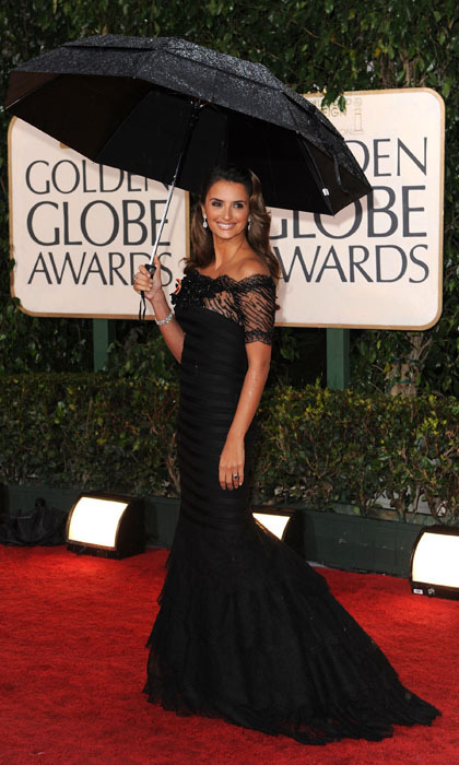 Not even a little rain could ruin the Spanish beauty's fashion parade at the 2010 Golden Globes, where the practical star held an umbrella to keep her Armani Privé gown dry from the drizzle.  (Photo by Steve Granitz/WireImage)