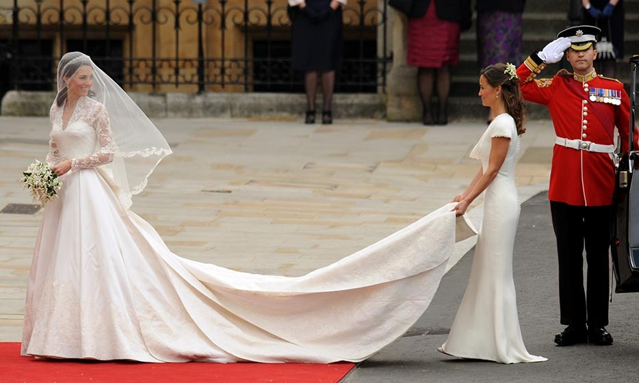 6.	English designer Sarah Burton, creative director of Alexander McQueen, designed the show-stopping bridal gown that Kate chose for her royal nuptials. Traditional yet modern, the long-sleeved dress featured a lace appliqué with details of a rose, thistle, daffodil and shamrock to represent each nation of the United Kingdom. The brunette beauty accessorized with a diamond Cartier tiara on loan from the Queen.