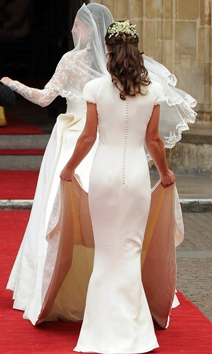 Kate's sister and maid of honour, Pippa, held the nine-foot train as the bride-to-be walked into the Abbey. It was Pippa's grand debut as the world's most famous sister, with her shapely figure garnering plenty of fans.