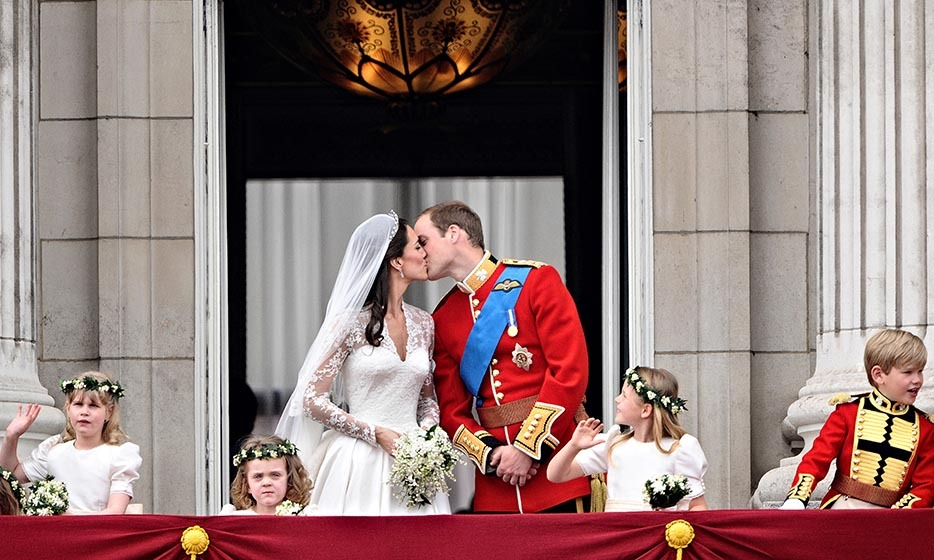 Following a tradition started by William's parents, the royal couple delighted fans by kissing on the balcony.