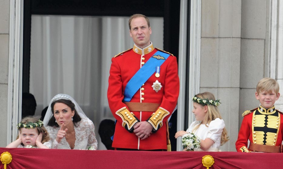 Kate tried to cheer up an unimpressed bridesmaid, five-year-old Grace Van Cutsem, who wasn't used to so much noise.