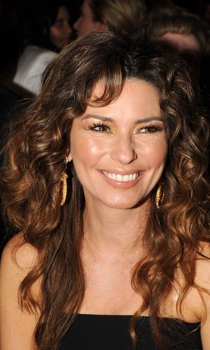 "SHANIA TWAIN: ""Fortunately, when you're a mom, the responsibility of caring for your child can keep you going."" - From her autobiography, 'From This Moment On.'"
